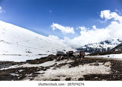 Cars parking among snow mountains at Zero point ,Sikkim,Northern India.