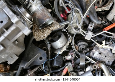 Car's part as garbage in a old garage