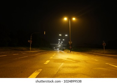 Cars passing on night road