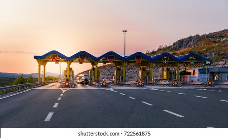 Cars passing through the toll gate on the motorway, vivid travel background