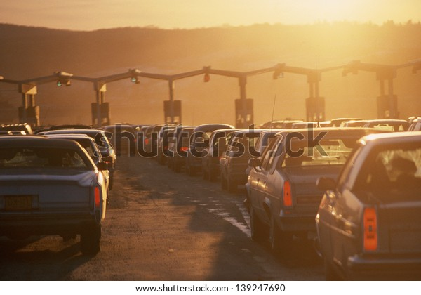 Cars queuing at a tollbooth