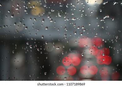 Cars red lights because the  traffic jam on road reflection on glass car with raindrops after rainy blurred background