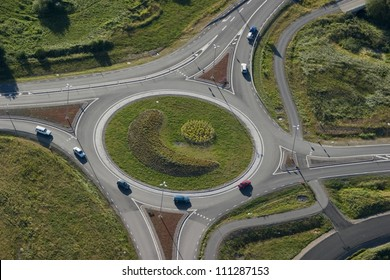 Cars in a roundabout