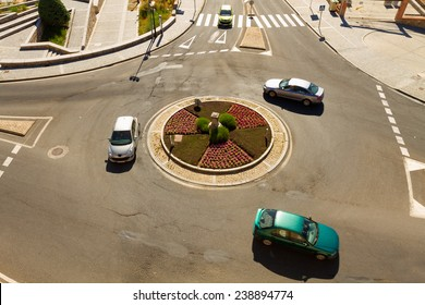 Cars in a roundabout in a high view