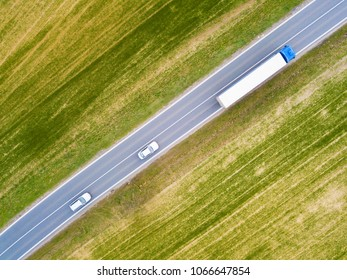 Cars in safe distance from truck. Aerial view from drone perspective. Road traffic concept background.