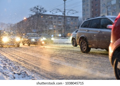cars in smoke of traffic jam of winter storm