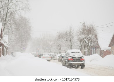 Cars in snow storm.