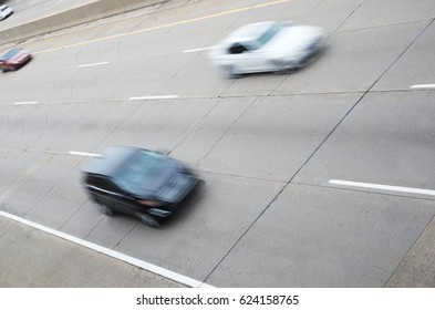 Cars Speeding By On The Highway