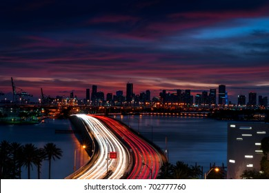 Cars Stream Over the Bridge at Sunset