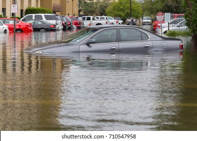 Cars submerged  in Houston, Texas, US during hurricane Harvey. Water could enter the engine, transmission parts or other places. Disaster Motor Vehicle Insurance Claim Themed. Severe weather concept