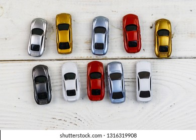Cars toys on white wooden background. Top view
