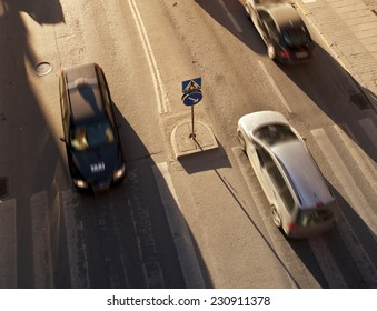 Cars in traffic at a pedestrian crossing