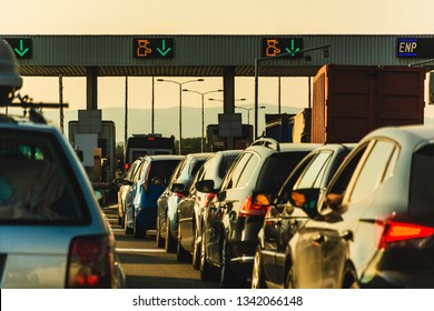 Cars and trucks waiting at point of toll highway - Toll station check point traffic jam - Highway toll peage