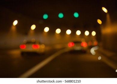Cars in a tunnel (background with bokeh from the colorful lights in a tunnel)
