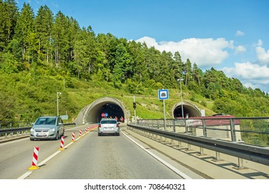 cars at tunnel entrance / exit on highway, german autobahn