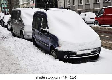 Cars under snow. Parked cars under snow.