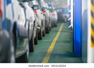 Cars waiting in line on deck of ferry in Norway, Scandinavia, Europe. Water transportation.