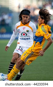 CARSON, CA. - JANUARY 10: Gerardo Flores (L) and Francisco Fonseca (R) in action during InterLiga 2010 match of Tigres vs. Jaguares at the Home Depot Center on January 10, 2010 in Carson.