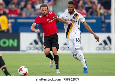 CARSON, CA - JULY 15: Juan Mata (L) & Bradley Diallo (R) during Manchester United's summer tour friendly against the L.A. Galaxy on July 15th 2017 at the StubHub Center.