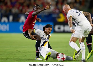CARSON, CA - JULY 15: Paul Pogba & Jermaine Jones during Manchester United's summer tour friendly against the L.A. Galaxy on July 15th 2017 at the StubHub Center.
