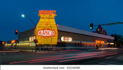 CARSON CITY, NEVADA - AUGUST 13: Traffic blurs at the intersection of the Carson Nugget Casino on August 13, 2013 in Carson City, Nevada