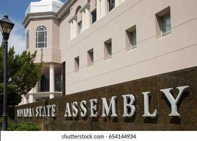 Carson City, NV – July 18, 2014:  Nevada State Assembly sign in front of the Nevada State Legislature building in Carson City.  The Nevada Legislature meets every other year for 120 consecutive days.