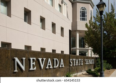 Carson City, NV – July 18, 2014:  Nevada State Senate sign in front of the Nevada State Legislature building in Carson City.  The Nevada Legislature meets every other year for 120 consecutive days.