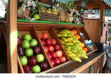a cart full of fresh fruits
