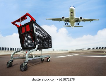 Cart at rooftop parking with plane on background