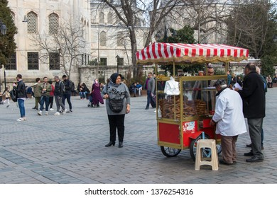 Cart selling simits. Oriental bagels sprinkled with sesame. Traditional turkish simit. Istanbul - Turkey: March 2019