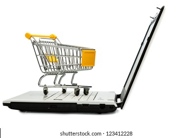 cart standing on the keyboard of a laptop, symbol photo for online shopping and consumer behavior