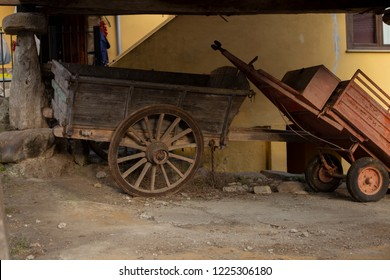 A cart is under a raised granary
