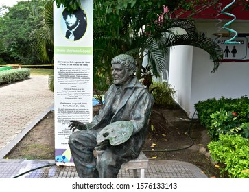Cartagena, Bolívar/Colombia; 11/30/2019: Monument in bronze to the Cartagena painter Dario Morales, who died in 1988. Work done by the sculptor Oscar Noriega in the park The mangrove spirit.