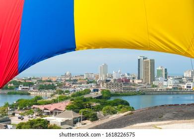 Cartagena, Bolivar, Colombia.  January 18, 2013:  Panoramic of the city of Cartagena and flag.