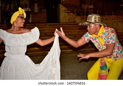 Cartagena, Bolívar/ Colombia; 01/04/2020:  Couple dance a cumbia, traditional rhythm and folk dance of Colombia, which has the contribution of three cultures, indigenous, black African and white.
