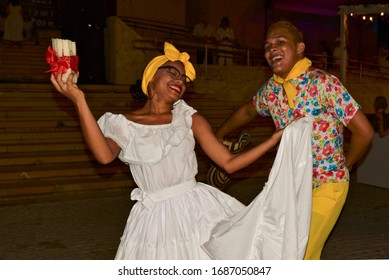 Cartagena, Bolívar/ Colombia; 01/09/2020; Young couple from the Colombian Caribbean dance happily a folk dance of the region