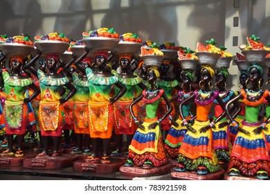 CARTAGENA, COLOMBIA - DEC 17, 2017 - Colorful statuettes of women and musicians in shop in Las Bovedas, Cartagena, Colombia