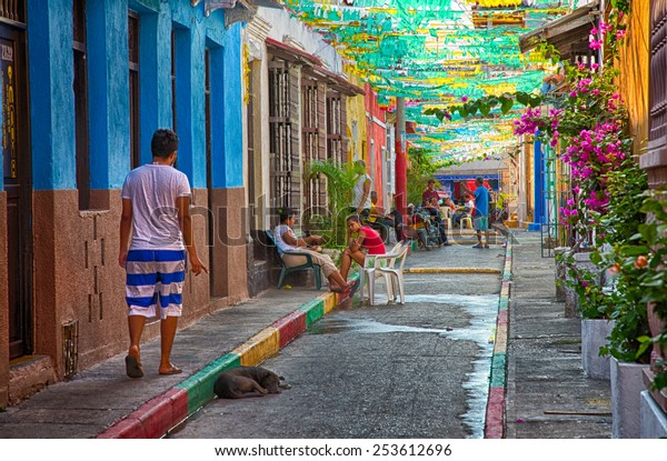 Cartagena, Colombia - February 23, 2014 - Locals gather in the late afternon in the colorful streets of Cartagena's Getsemani neighborhood.