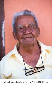 CARTAGENA, COLOMBIA, JANUARY 11 2014: Unidentified portrait of an old man looking at the camera in Cartagena, Colombia.