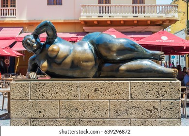 Cartagena, Colombia - March 21, 2017: This huge statue of a woman is called Fat Lady. The reclining figure was created by sculptor Fernando Botero. He is a famous artist from Medelli­n, Colombia.