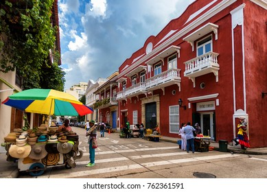 CARTAGENA, COLOMBIA - NOV 2: Multiple vendors at a street corner in Cartagena, Colombia on November 2, 2017. The city is recognized by UNESCO for its Spanish colonial architecture.