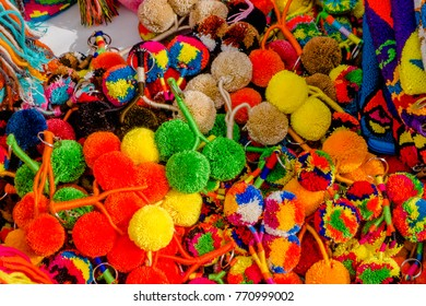 CARTAGENA, COLOMBIA - OCTOBER, 27, 2017: Close up pf colored colombian keychain made of whool in a public market in Cartagena