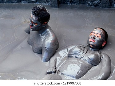 CARTAGENA, COLOMBIA - OCTOBER 29, 2015: People bathing in El volcan del Totumo. The volcano is a couple hundred meters and many tourist come here to bathe in the mud.