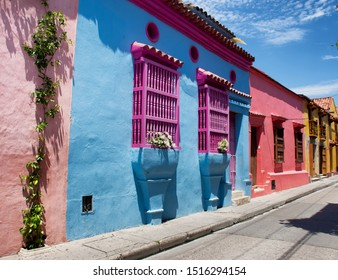 Cartagena de Indias, Bolivar/Colombia: 09/27/2019: Facade typical of the San Diego neighborhood in the heart of Cartagena de Indias, mixed with alive colors in door, windows and wall with the people