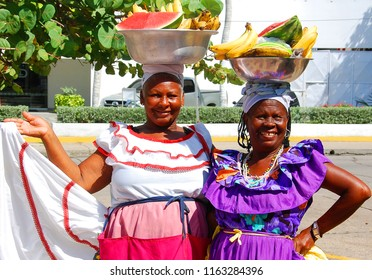 CARTAGENA DE INDIAS COLOMBIA 11 07: Palenquera woman sells fruit on november 7 2012 in Cartagena, Colombia. Palenqueras are a unique african descendant ethnic group found in the north of South America