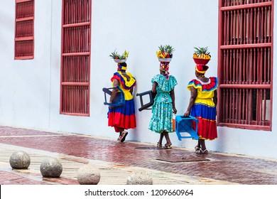 CARTAGENA DE INDIAS, COLOMBIA - AUGUST, 2018: Traditional fruit street vendors in Cartagena de Indias called Palenqueras