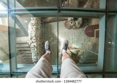Cartagena, Spain - September 14th, 2018: Visitor over the glass floor of Punic Wall Interpretation Center