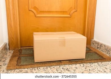 carton box on the floor of doorway home
