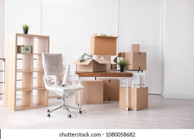 Carton boxes with stuff in room. Office move concept