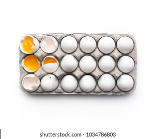 Carton of cracked eggs from above